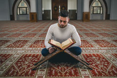 Muslim praying. Young Muslim man praying in mosque Royalty Free Stock Images