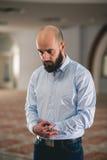 Muslim praying. Young Muslim man praying in mosque Royalty Free Stock Image