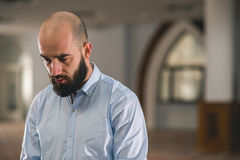 Muslim praying. Young Muslim man praying in mosque Stock Photos