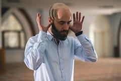 Muslim praying. Young Muslim man praying in mosque Stock Photography