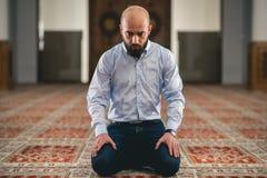 Muslim praying. Young Muslim man praying in mosque Royalty Free Stock Photos