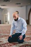 Muslim praying. Young Muslim man praying in mosque Stock Photo