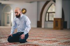 Muslim praying. Young Muslim man praying in mosque Royalty Free Stock Photography