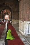 Muslim pregnant woman praying. In a mosque, Delhi, India Royalty Free Stock Photo