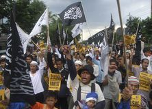 MUSLIM PROTEST SHARIA LAW SECULAR GOVERNMENT. A Muslim group participate on a rally to demand full application of Islamic Sharia law on state affairs. Although Stock Photo