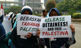 Muslim Protesters. JAKARTA, INDONESIA - MAY 18, 2017: Indonesian Muslims from Aqsa Working group staged rallies in front of the US embassy at Menara Thamrin Royalty Free Stock Image