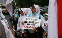Muslim Protesters. JAKARTA, INDONESIA - MAY 18, 2017: Indonesian Muslims from Aqsa Working group staged rallies in front of the US embassy at Menara Thamrin Stock Images