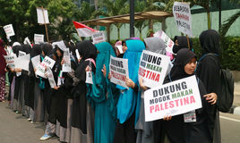 Muslim Protesters. JAKARTA, INDONESIA - MAY 18, 2017: Indonesian Muslims from Aqsa Working group staged rallies in front of the US embassy at Menara Thamrin Royalty Free Stock Photography