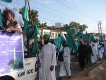 Muslim Qasida or Nasheed in Africa. Muslims march in Nairobi Kenya on the occasion of Milad un Nabi commemorated every year accompanied by Qasida group Stock Photo