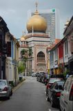 Muslim Quarter in Singapore on a partly cloudy day showing off the streets and mosque attraction for the Muslim population an stock photo