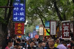 The Muslim quarter in Xi`An flocked by tourists. The area is fam stock photo
