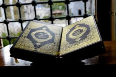 Muslim Quran book on a stand stock photography