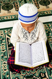 Muslim Reading Koran Stock Images