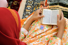 Muslim Reading Koran Stock Photo