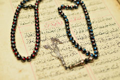 Muslim rosary beads on the Holy Quran Royalty Free Stock Photography