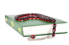 Muslim rosary beads and Quran. Muslim rosary beads on the Holy Quran stock image