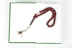 Muslim rosary beads and Quran. Muslim rosary beads on the Holy Quran royalty free stock images