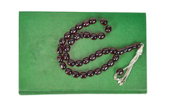 Muslim rosary beads and Quran Stock Photo