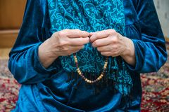 Muslim rosary in the hands of an elderly woman stock images