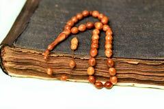 Muslim rosary on the koran Royalty Free Stock Photos