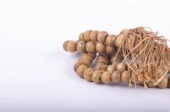 Muslim rosary prayer beads on white background. Closeup image of Muslim rosary wood prayer beads on white background Royalty Free Stock Images