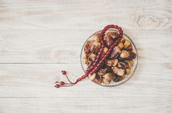 Muslim rosary on wooden background. Selective focus royalty free stock photos