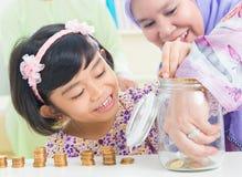 Muslim saving money concept Royalty Free Stock Photos