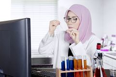 Muslim scientist doing experiment in the lab Stock Photo
