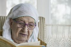 Muslim senior woman praying Stock Photography