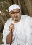 Muslim smoking hookah Royalty Free Stock Photography