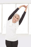 Muslim sporty woman doing hand stretching Stock Photography