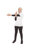 Muslim sporty woman doing hand stretching while smiling Stock Image