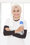 Muslim sporty woman holding a bottle of mineral water Stock Photos
