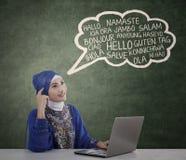 Muslim student learn multilanguage 1 Stock Photos