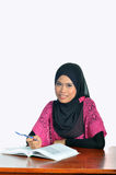 Muslim student with notebook and pen Stock Photo