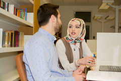 Muslim students in library royalty free stock image