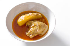 Muslim style chicken and potato curry or chicken mussaman curry. On white background Stock Photography