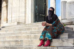 Muslim Style dressed Lady sitting on Marble Steps of Blue Mosque Royalty Free Stock Image