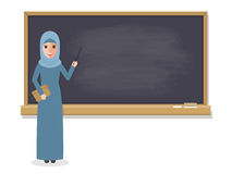 Muslim teacher teaching student in classroom Royalty Free Stock Photos