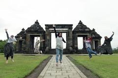 Muslim Tourist Jumping Happily In Historic Area Ratu Boko Royalty Free Stock Image