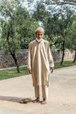 Muslim tribal man wearing. DELHI, INDIA - NOVEMBER 11, 2011: A muslim tribal man wearing traditional taqiyah (muslim cap) and galabia poses in the garden of Stock Photos