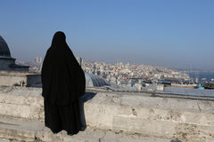 Muslim veiled woman watching the cityscape of Istanbul Royalty Free Stock Images
