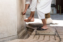 Muslim Washing Feet Before Entering Mosque Royalty Free Stock Images