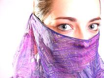 Muslim woman 4. High key portrait of a muslim woman with a violet veil royalty free stock photo