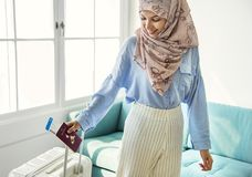 Muslim woman all ready to travel Stock Images