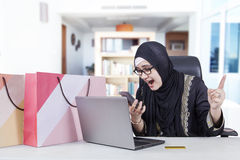 Muslim woman angry after shopping online Stock Images