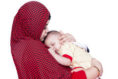 Muslim woman and baby boy. Portrait of muslim women kiss her baby boy in the studio, isolated on white Royalty Free Stock Photos