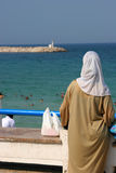 Muslim woman at the beach Stock Photography