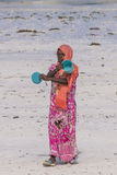 Muslim Woman on the beach stock photography
