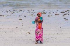 Muslim Woman on the beach Stock Photos